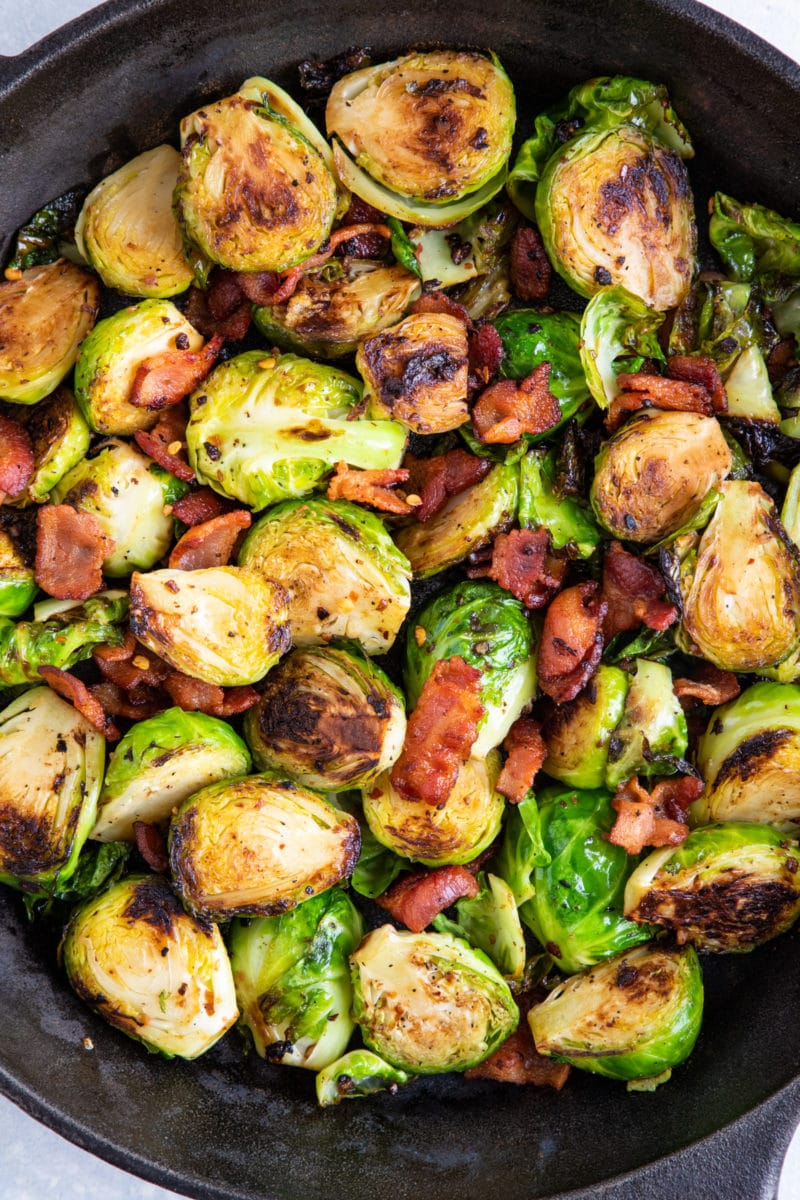 Close up of the cooked sprouts with pieces of bacon.