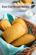 Four loaves of cornbread in a wooden basket.