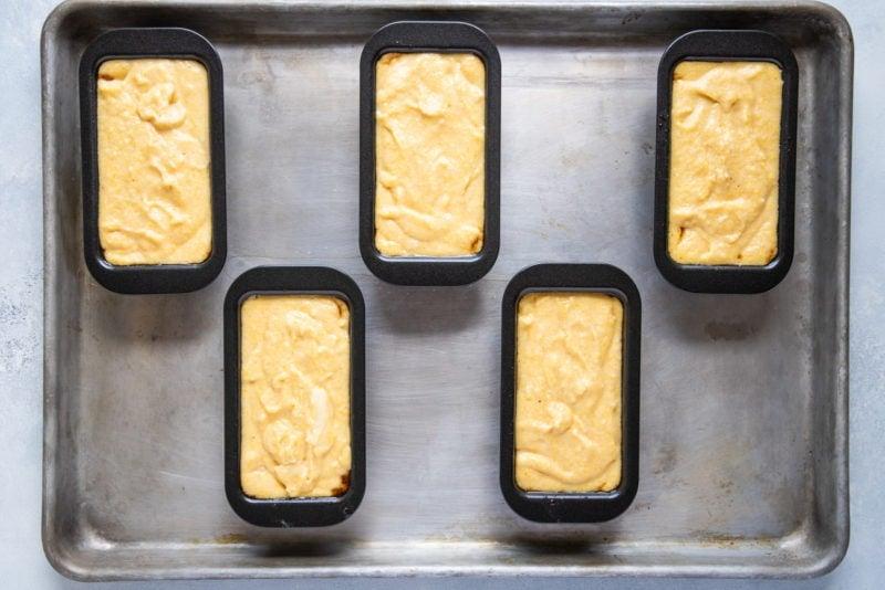 Cornmeal batter in baking tins.