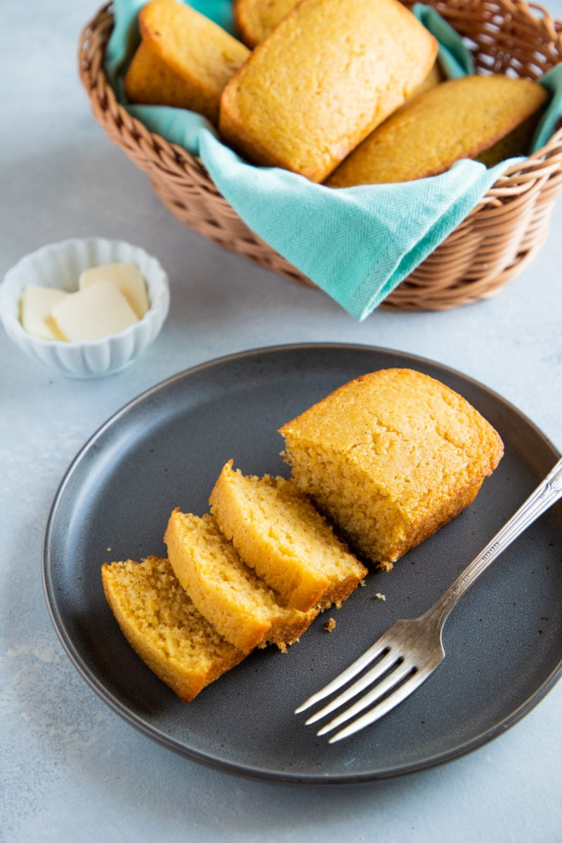 A loaf of cornbread cut into slices.