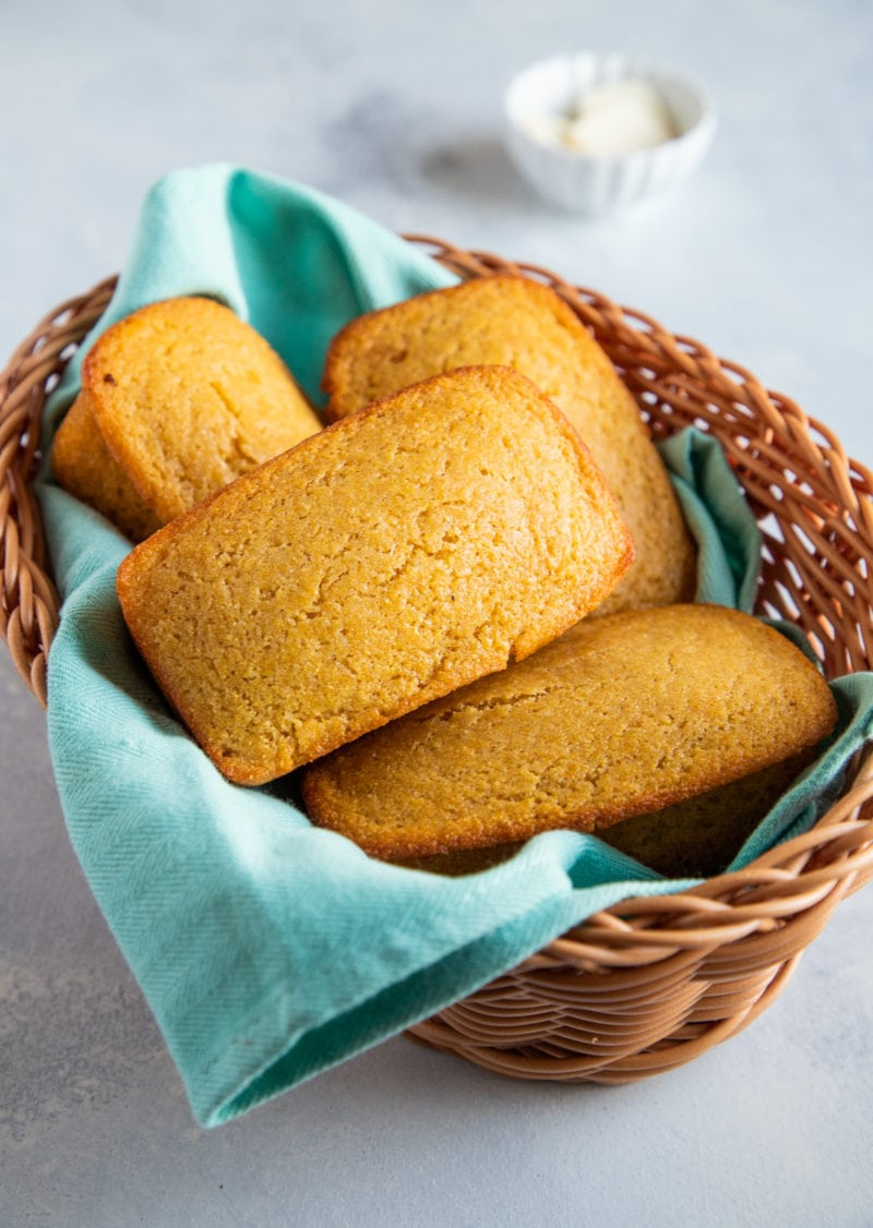 Loaves of cornbread in a basket.