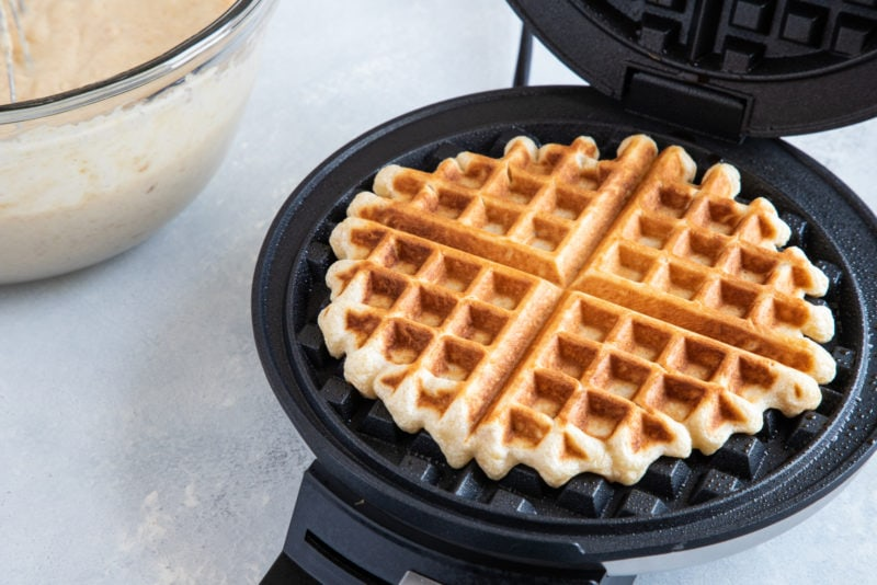 Cooked Churro Waffles with Dulce de Leche in the waffle maker
