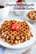 Close up of two waffles served on a white plate drizzled with dulce de leche.