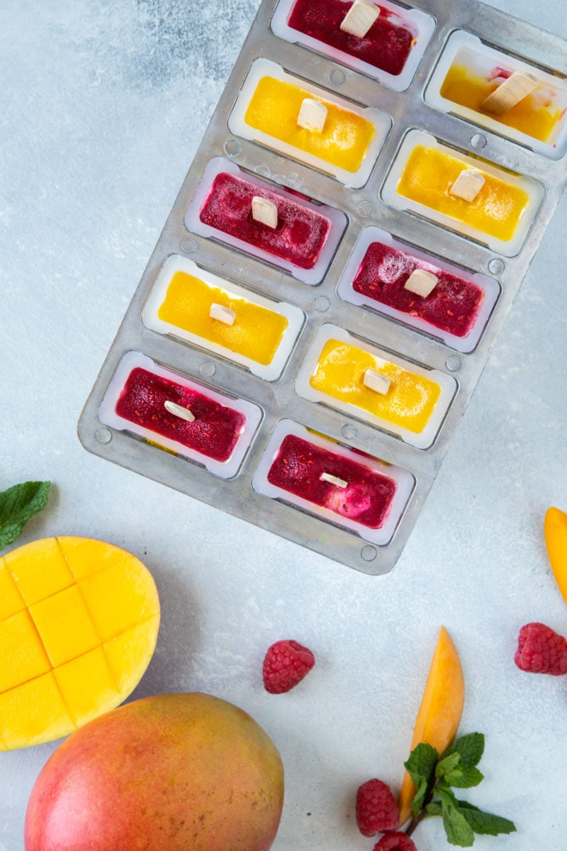 Mango Raspberry Yogurt Popsicles in popsicle molds.