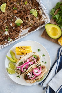 The pork carnitas served in two tortillas with red onion.