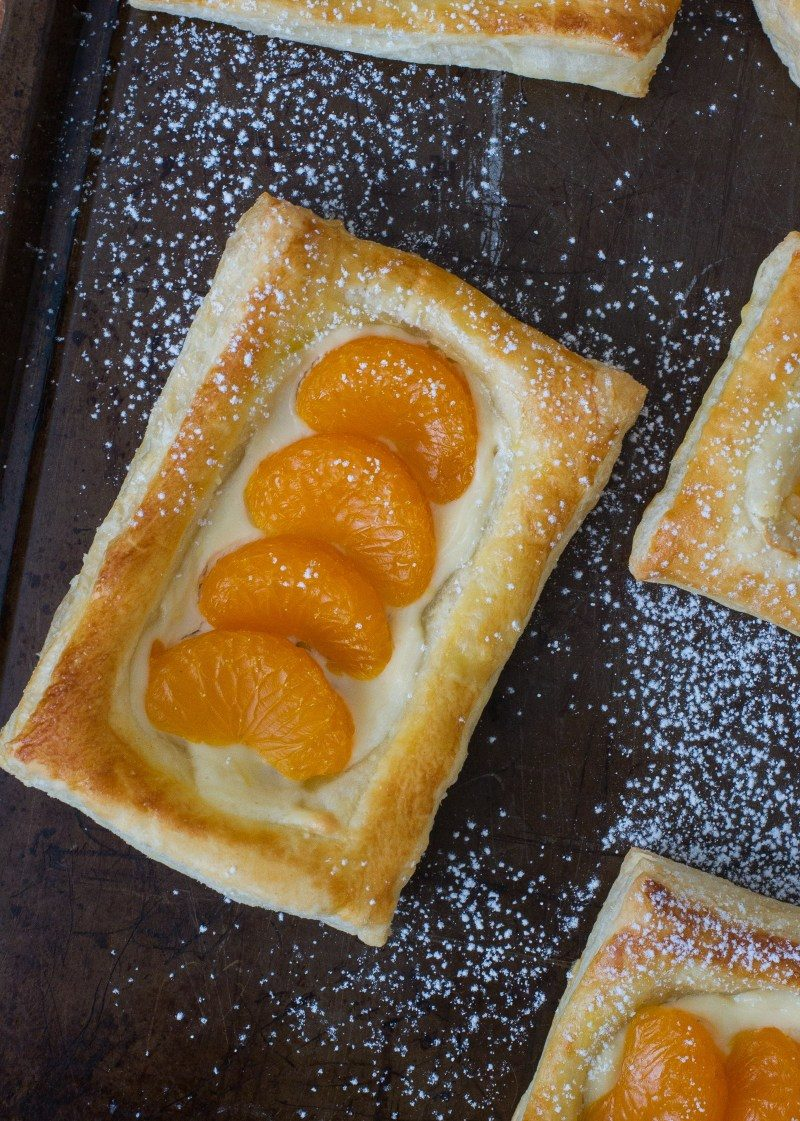 A mandarin pastelito dusted with confectioners\' sugar.