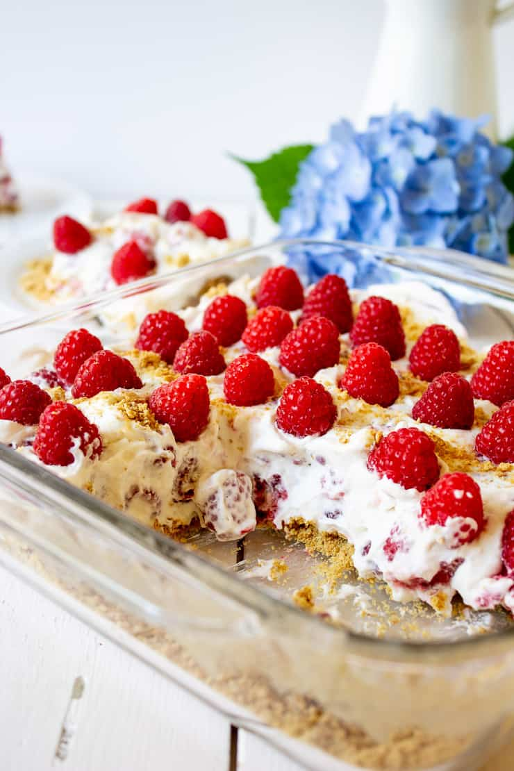 A raspberry cake in a glass baking dish.