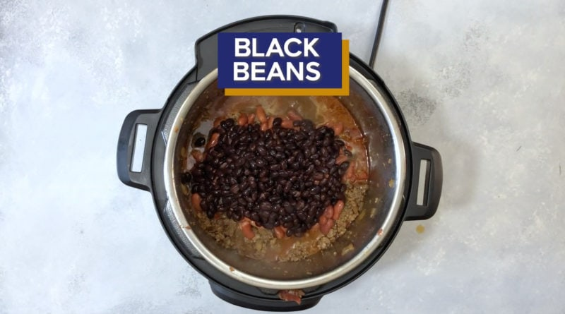 Black beans added to the Instant Pot.