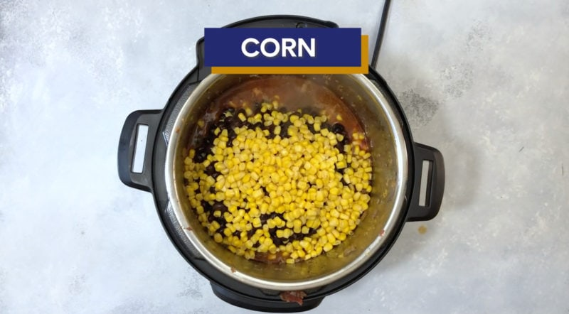 Corn added to the Instant Pot.