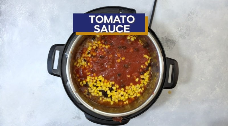 Tomato sauce added on top of the corn.
