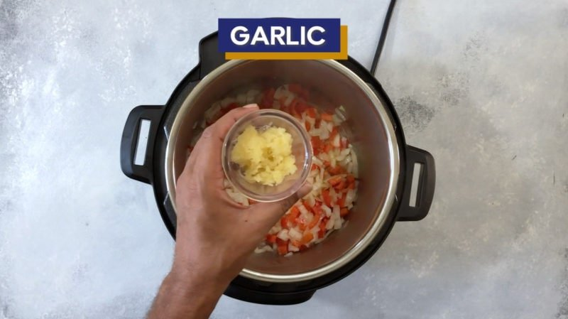 Garlic added to the onion and bell pepper.