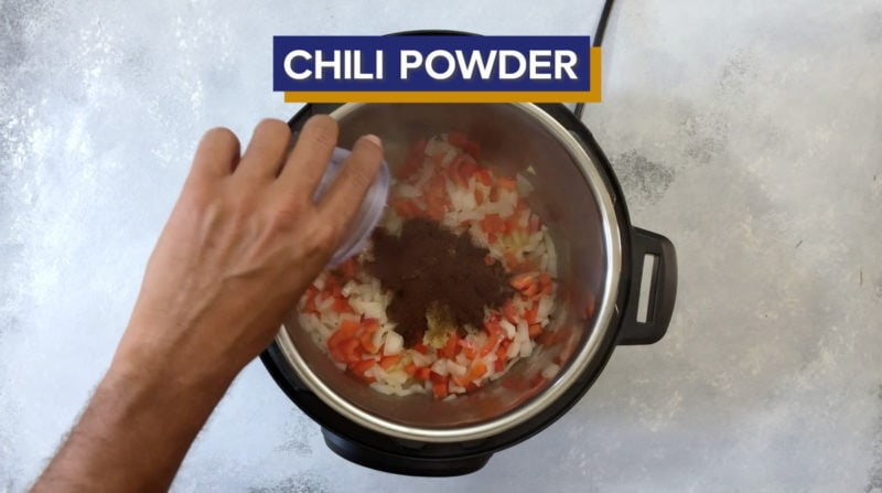 Chili powder added into the Instant Pot.