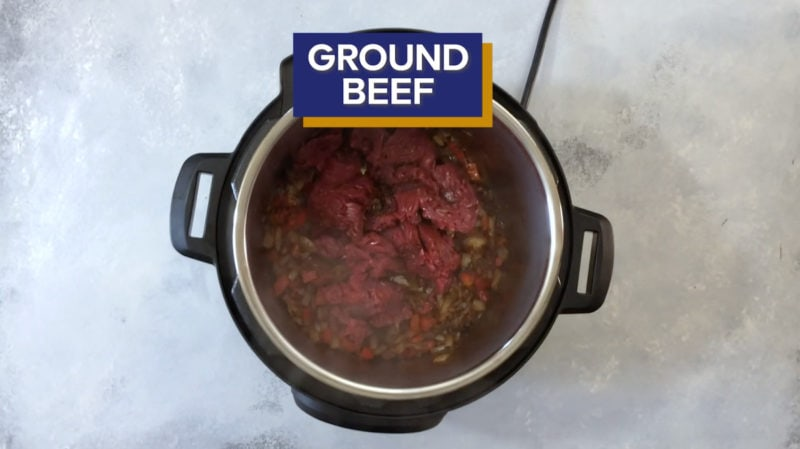 Ground beef added to the other ingredients in the Instant pot.