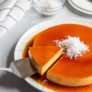 slice of coconut flan being served