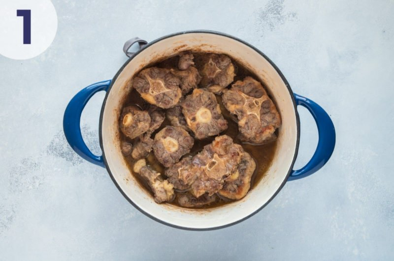 Browning the oxtail in a cooking pot