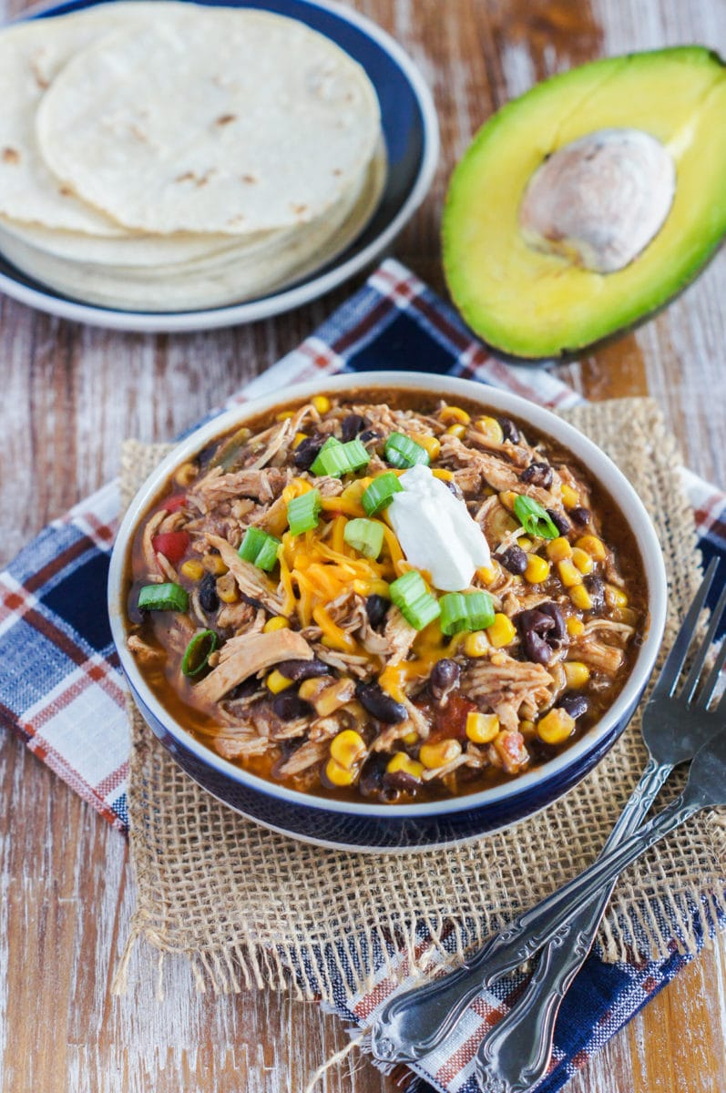 Taco chili served with toppings and forks