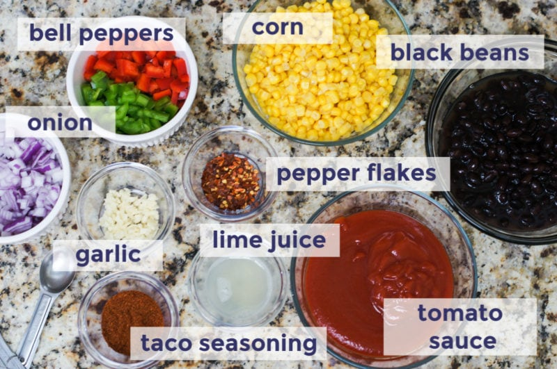 Slow cooker taco chicken chili ingredients laid out on a counter
