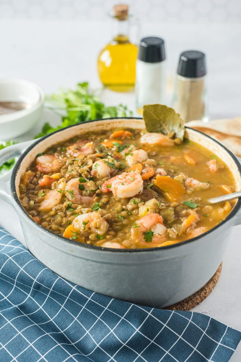 lentil stew with shrimp in a dutch oven on the table