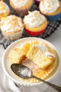 coconut tres leches cupcake on a white plate