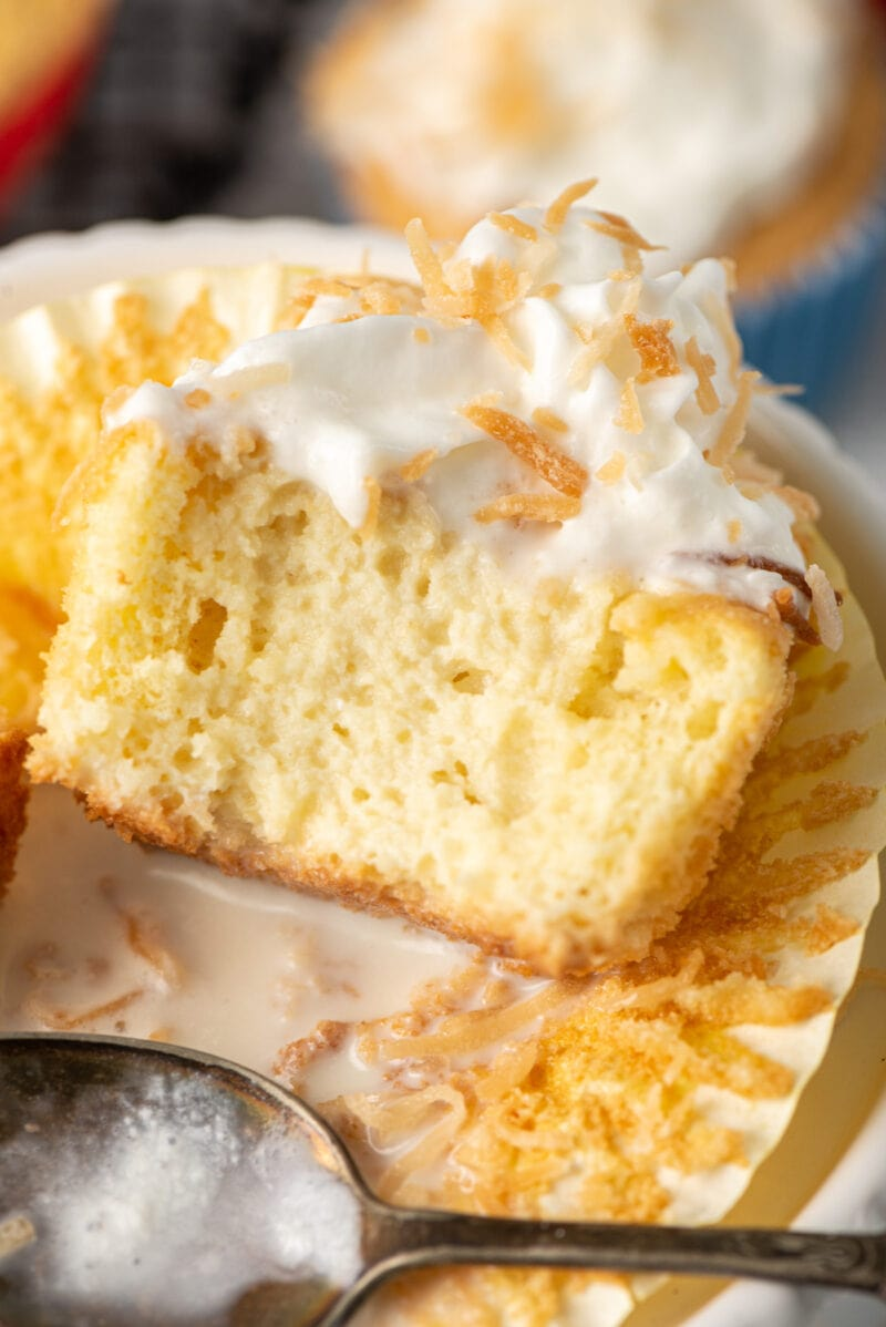 Close up of tres leches cupcake cut in half