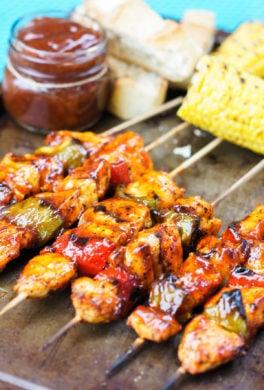 honey chipotle chicken skewers on a baking sheet