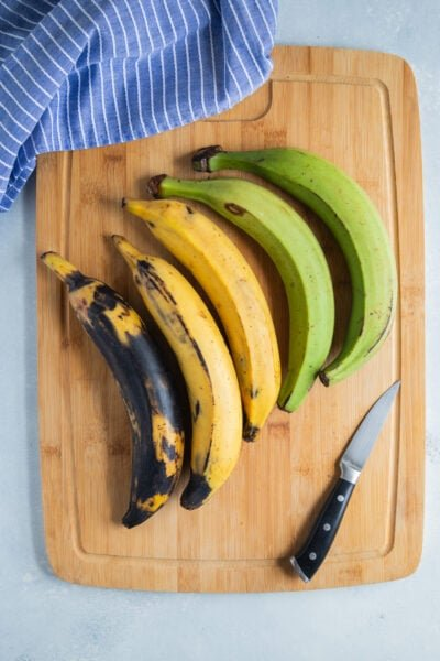 Plantains on a wooden chopping board