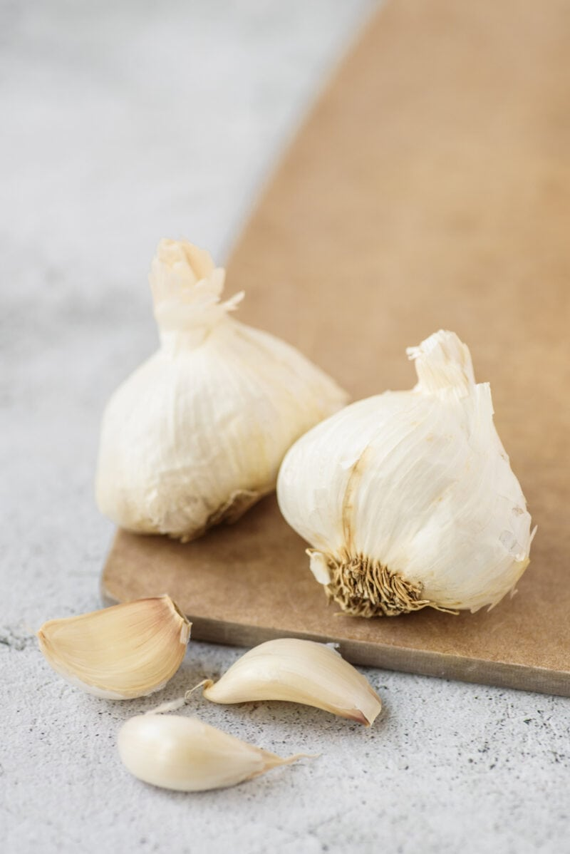 Garlic Bulbs and cloves on a wooden board