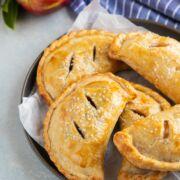 Apple empanadas on a gray plate