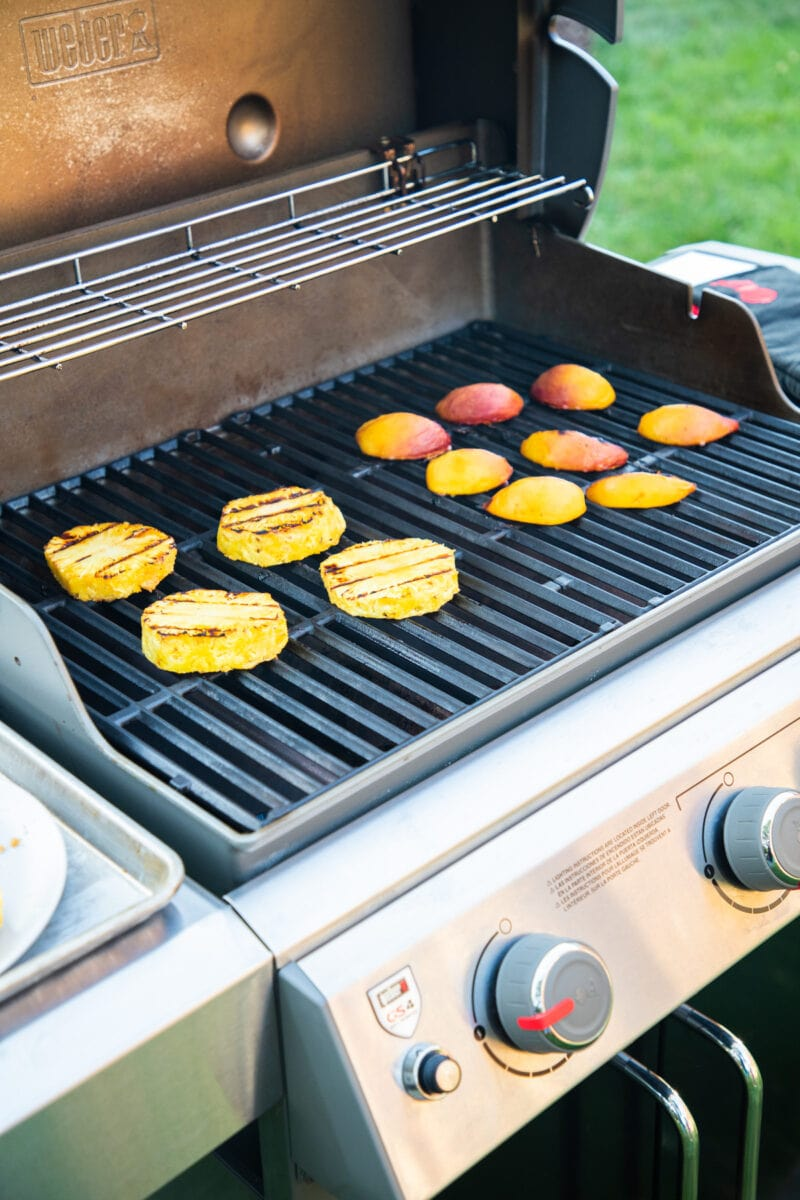 pineapple and peaches cooking on the grill