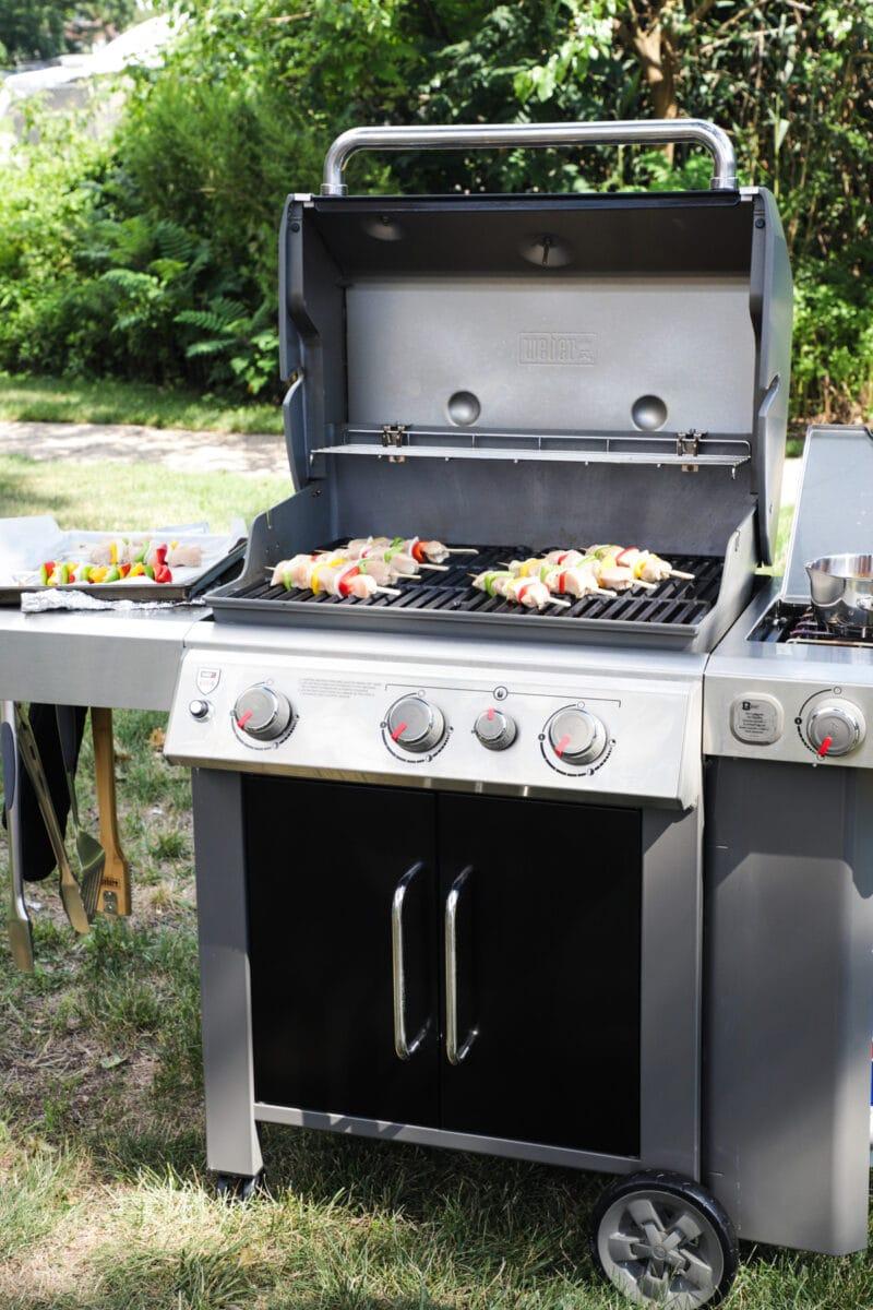 Weber Genesis II grill on the grass outside