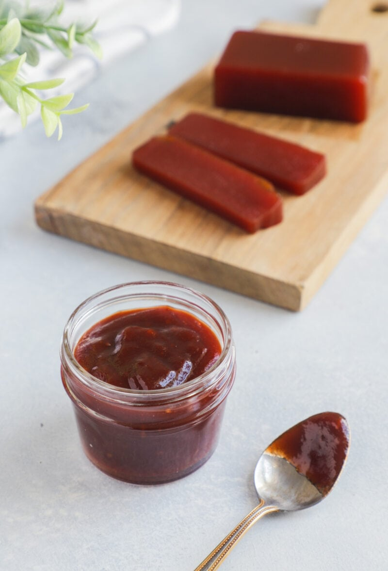 Guava bbq sauce in a glass jar next to a spoon