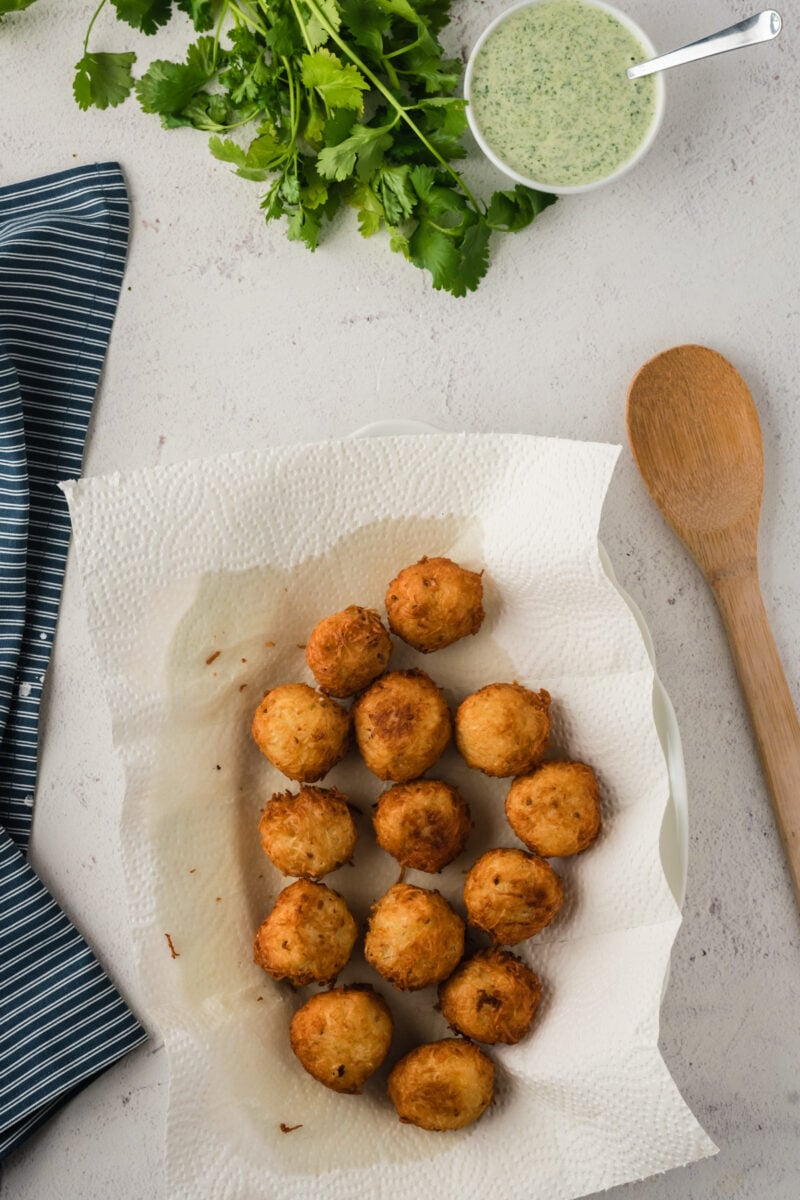 The fried balls laid on parchment