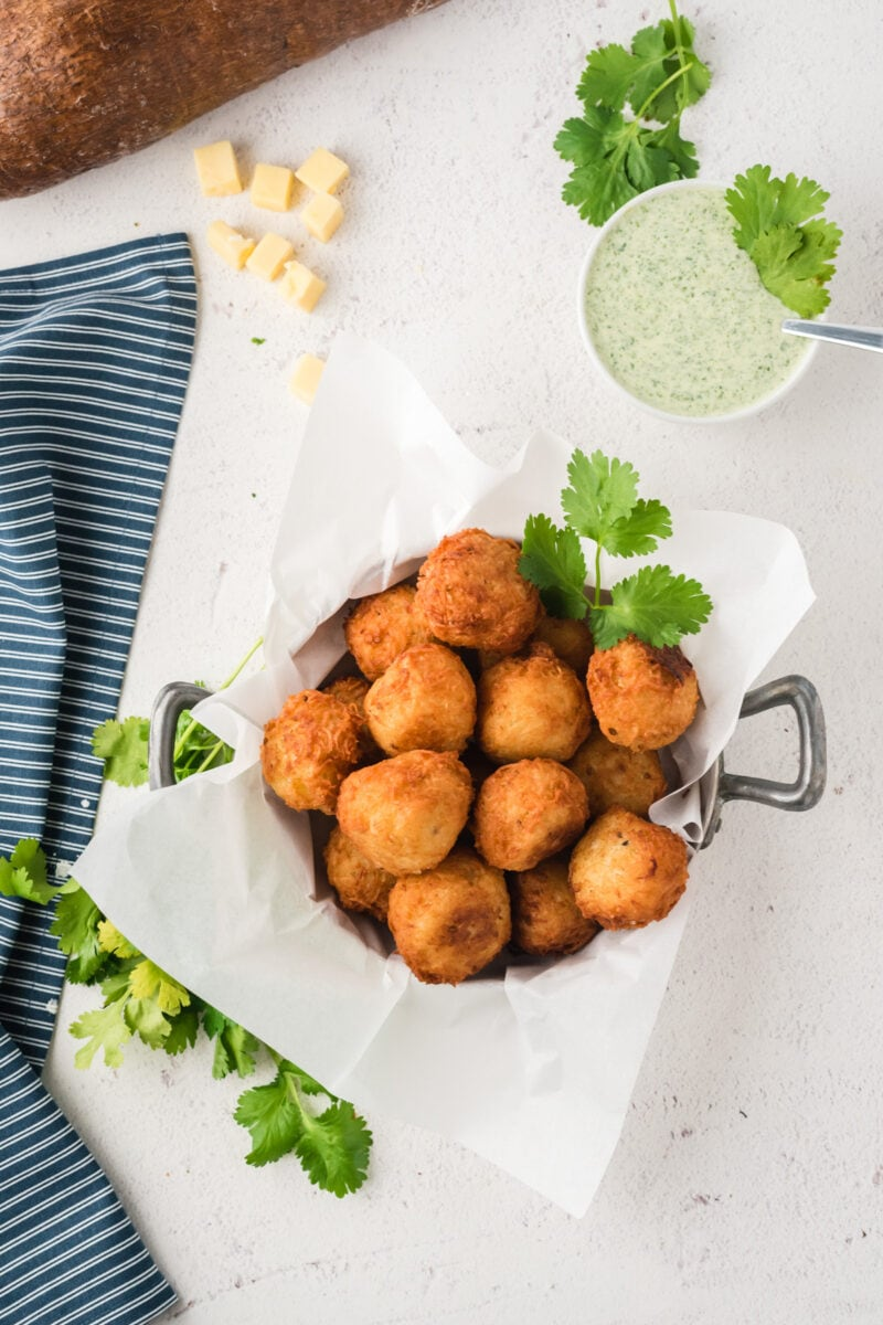 Overhead shot of the yuca balls served on parchment paper