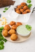 Yuca balls and dip served on a plate