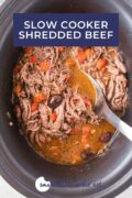 A spoon stirring the shredded beef in a slow cooker - Pinterest Graphic