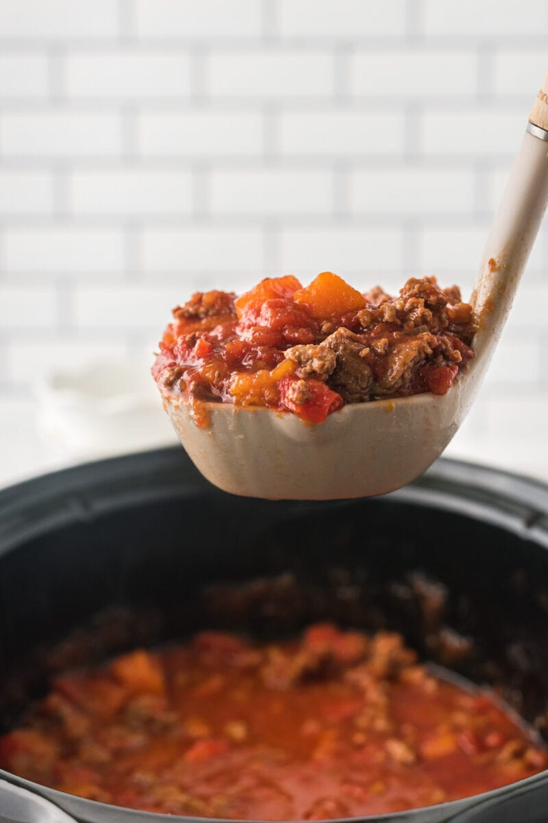 The chili being served on a ladle.