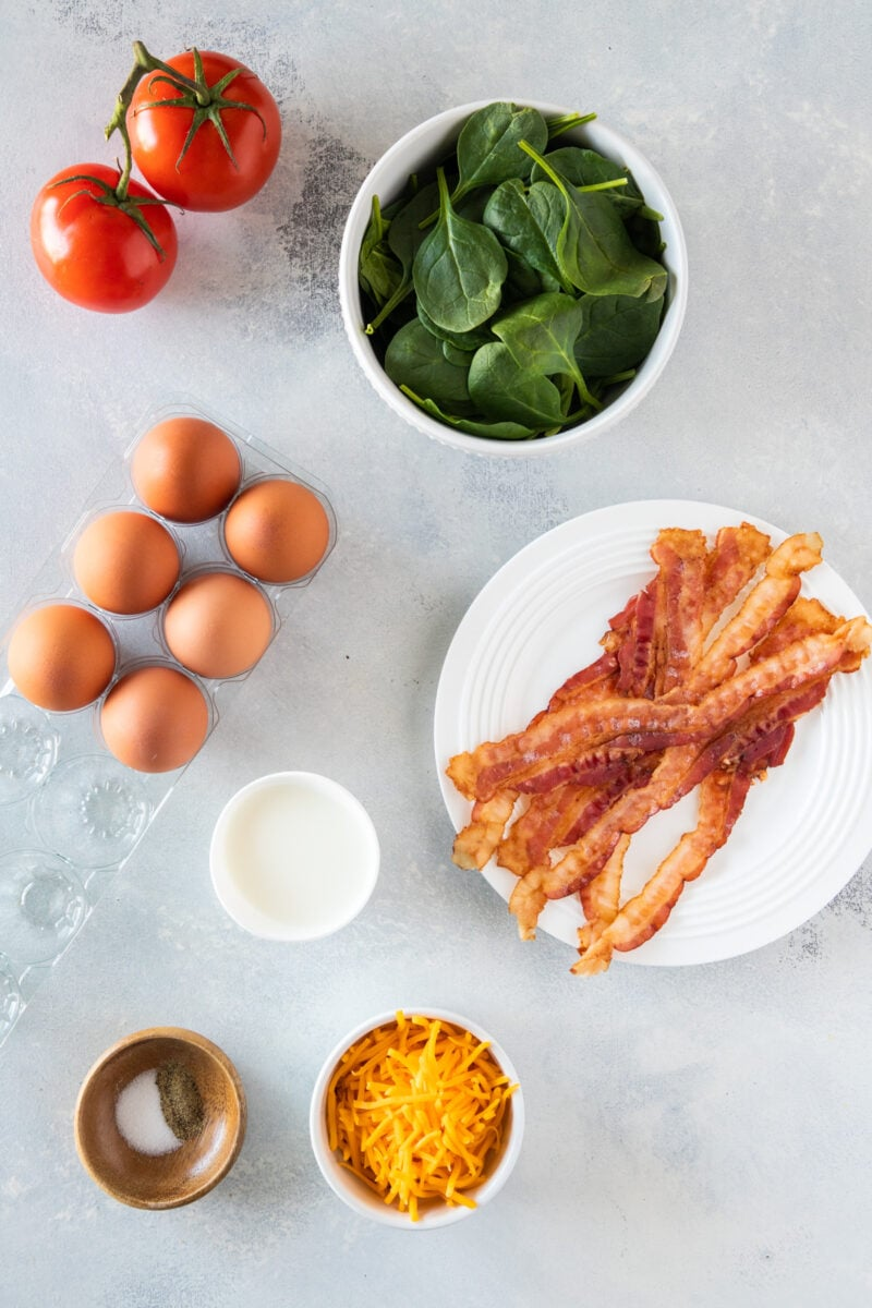 Bacon and Egg Muffins Ingredients on a white counter top