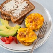 Bacon and Egg Muffins served with toast and avocado