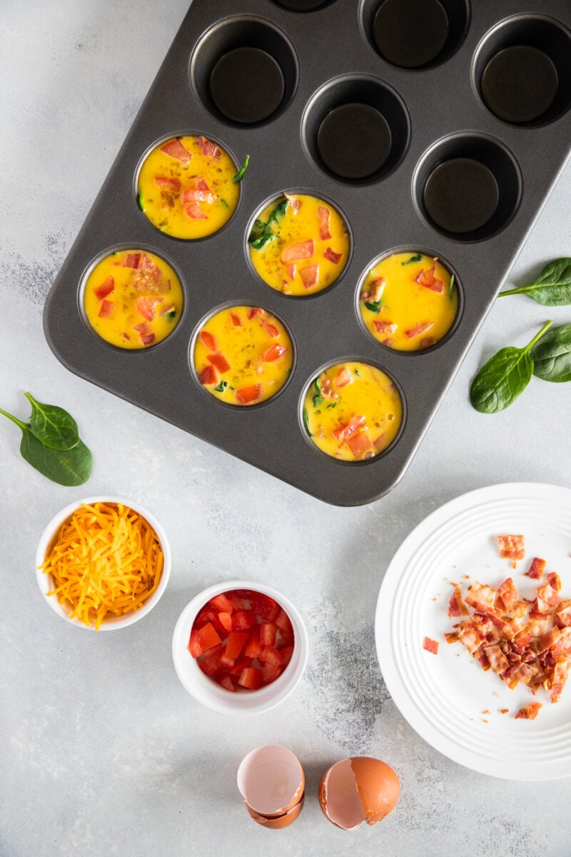 Bacon and Egg muffins mixture in a muffins baking pan