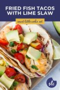 close up of fried fish tacos topped with avocado pinterest graphic
