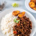 Picadillo served with rice and plantains on the side ready to eat