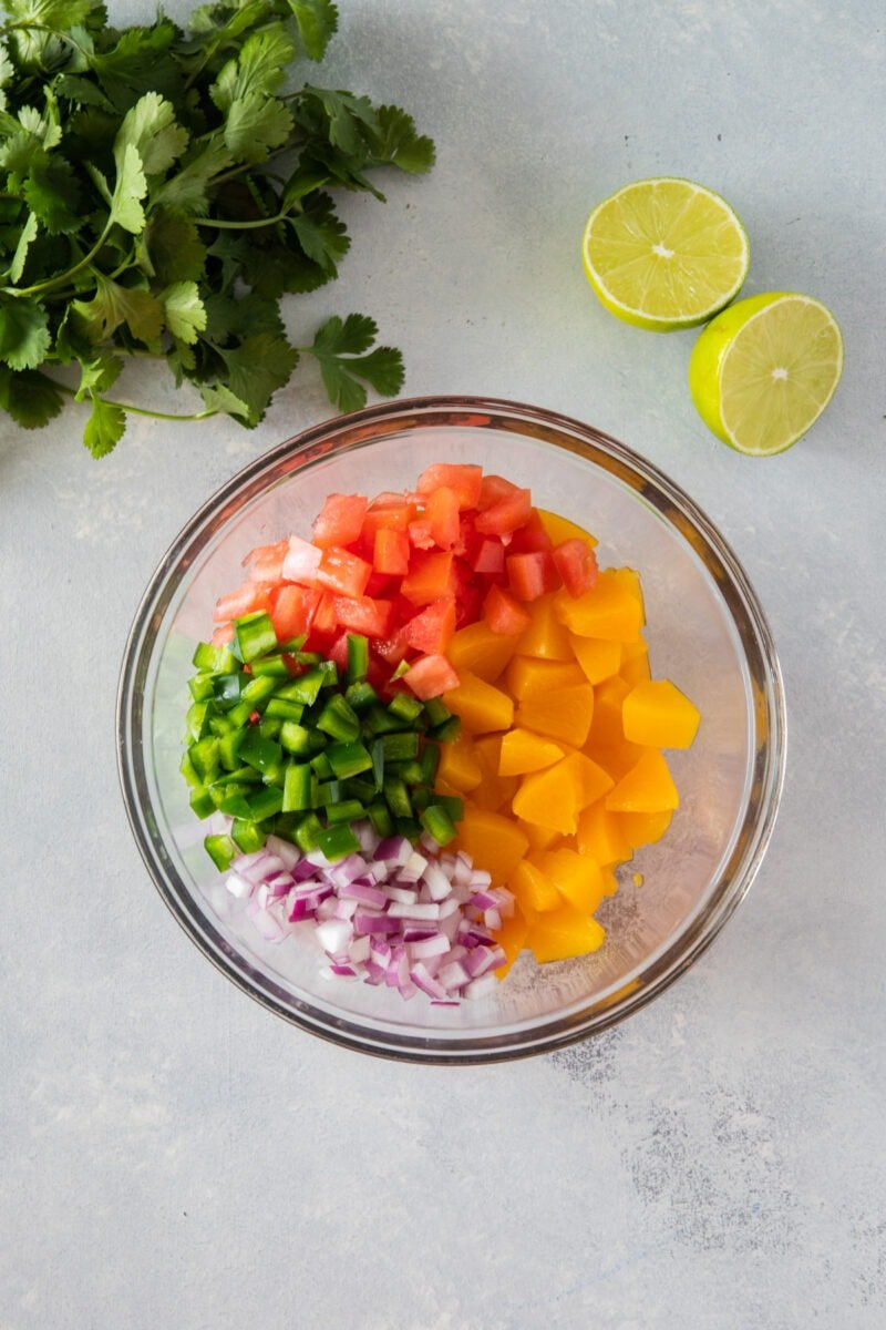 peach salsa ingredients in a bowl