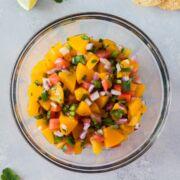 peach salsa in a clear bowl