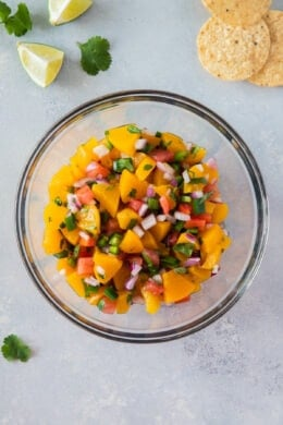 peach salsa in a clear bowl