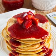strawberry pancakes with homemade strawberry sauce over the top
