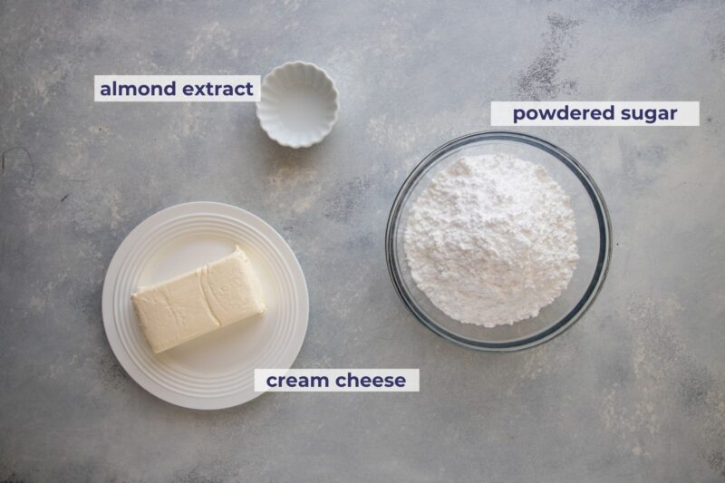cream cheese frosting ingredients placed on a board