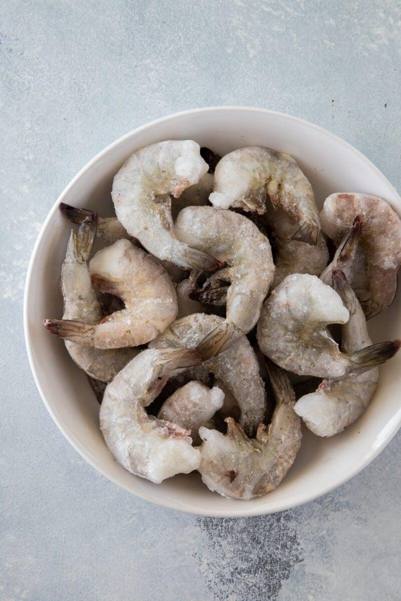 jumbo frozen raw shrimp in a bowl
