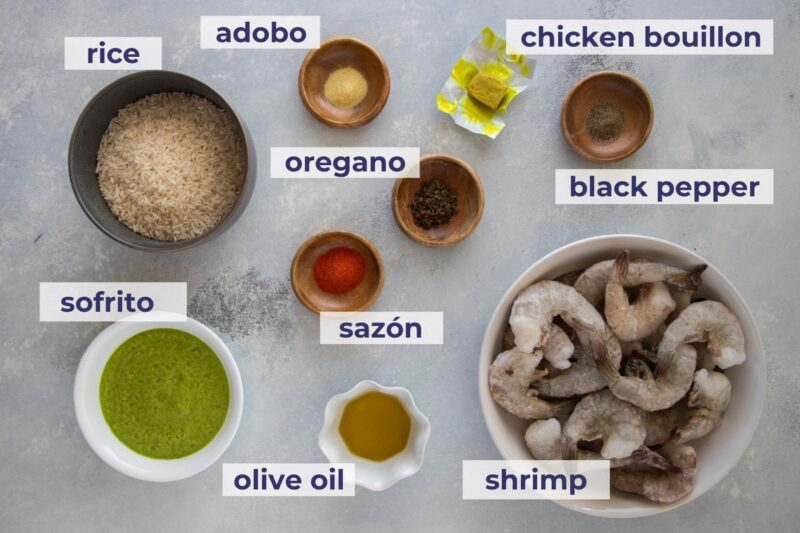 shrimp and rice soup ingredients on a board
