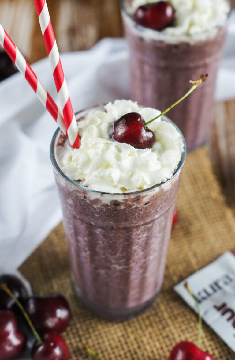 Chocolate Cherry Smoothie in a glass topped with a cherry