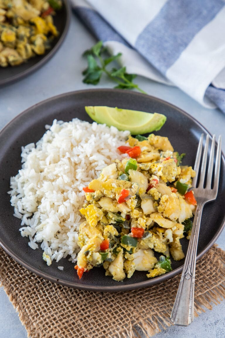 Bacalao con huevos served with rice and avocado on the side
